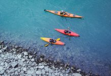 three touring kayakers