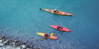 three touring kayakers