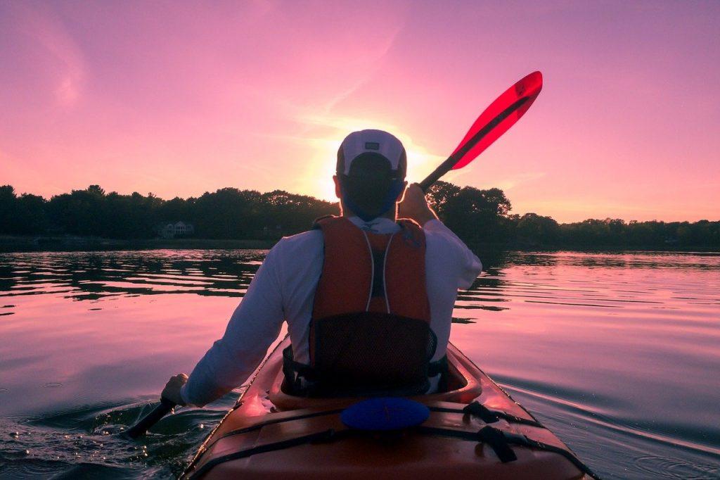 Flatwater kayaker at sunrise