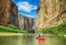 canoe in canyon with cooler