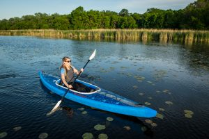 Person paddling inflatable kayak Advanced Elements Airvolution
