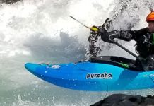 2021 Pyranha Scorch whitewater kayak paddled by Nick Hinds wearing Stohlquist PFD as he boofs on Canyon Creek of the Lewis river in WA