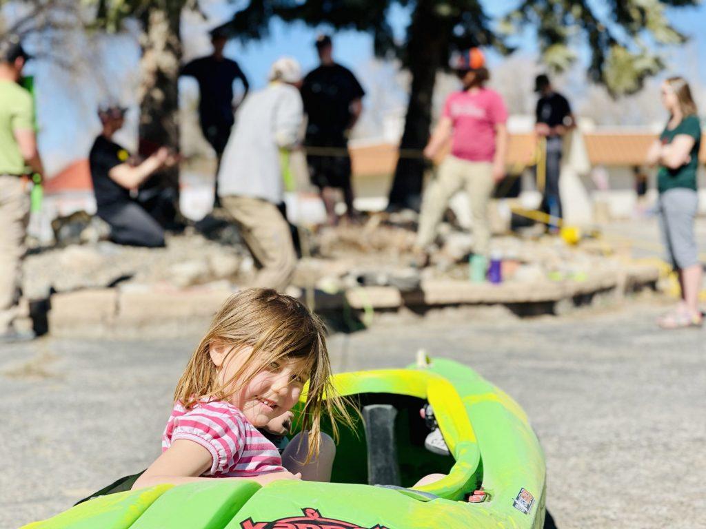 Good Vibes Raft Gear instructing a z-drag workshop - dragging Pyranha kayak across parking lot