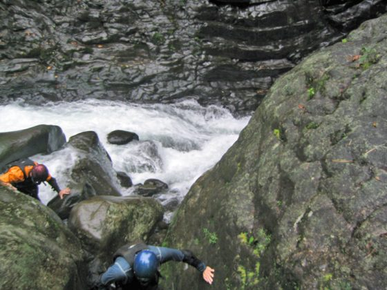 kayakers scouting a rapid on the the Rio Patria