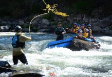 Tahoe Whitewater Tours raft wrapped in Jaws on the Truckee river, CA.
