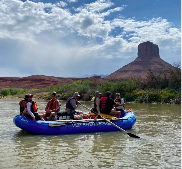 Senator Michael Bennet (D-CO) and Mitt Romney (R-UT) float together on the Colorado River to help address climate change and water in the West. (Photo courtesy Jason Blevins/The Colorado Sun)